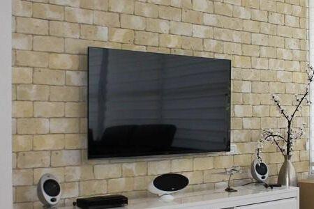 电视挂墙离地面多高合适?电视挂墙安装的方法是什么样?