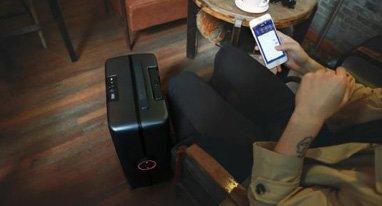 这个行李箱能像狗狗一样跟在身后 解放双手